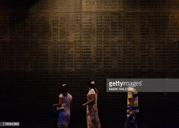 Chinese tourists view names of victims at the Nanjing Massacre Memorial Museum in Nanjing on August 16 2013 Japan's conservative prime minister on...
