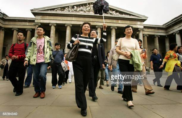 Chinese tourists visit the British Museum on July 25 2005 in London In 2004000 Chinese citizens traveled to the UK but were only allowed to do so for...