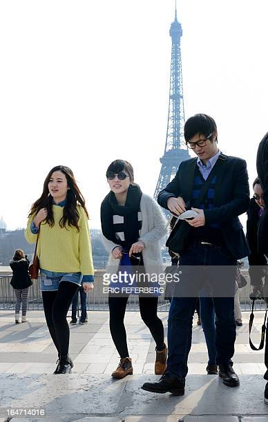 Chinese tourists visit the Trocadero which gives a good view of the Eiffel tower on March 27 2013 in Paris AFP PHOTO / ERIC FEFERBERG
