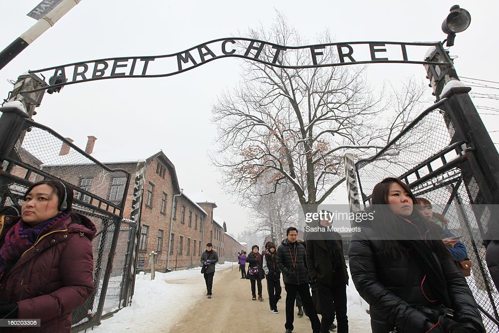 Chinese tourists walk through the gates at the former Auschwitz Birkenau Nazi concentration camp January 27, 2013 near Oswiecim, Poland. A ceremony marked the 68th anniversary of the liberation of the camp during International Holocaust Remembrance Day.