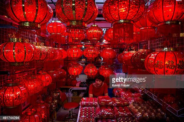 Chinese trader waits for customers at her stall selling wholesale Chinese lanterns at the Yiwu International Trade City on September 19 2015 in Yiwu...