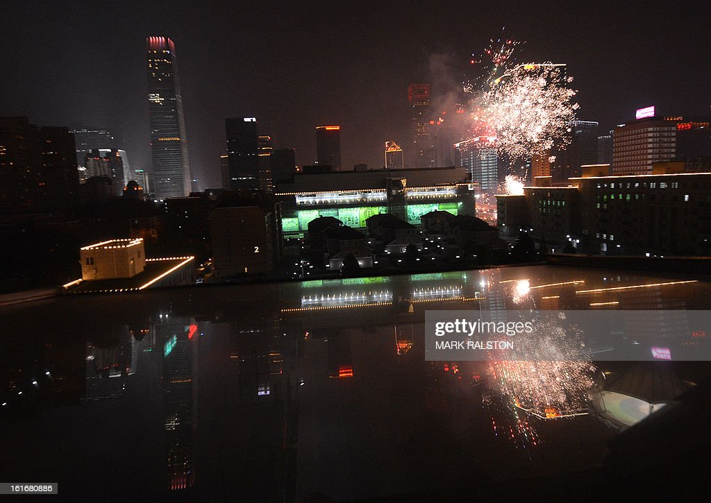 Chinese traders let off fireworks to acknowledge the 'god of wealth' outside the Silk Market and bring their businesses prosperity and good fortune on the fifth day of the 'Year of the Snake' in Beijing on February 14, 2013. China is welcoming the Year of the Snake and tradition proclaims that a snake in the house is a good sign because it means the family will not starve and children born in the Year of the Snake will be cunning, intelligent and wise. AFP PHOTO/Mark RALSTON