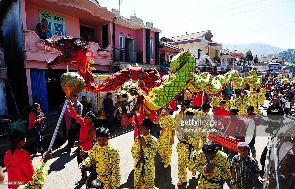 A Chinese traditional art performs during Ruwatan Rambut Gimbal parade on August 31, 2014 in Dieng, Java, Indonesia. The Dieng Culture Festival is an annual event presenting a variety of arts and culture culminating with a hair trimming ritual ceremony of dreadlocked children, known as the Ruwatan Rambut Gimbal.