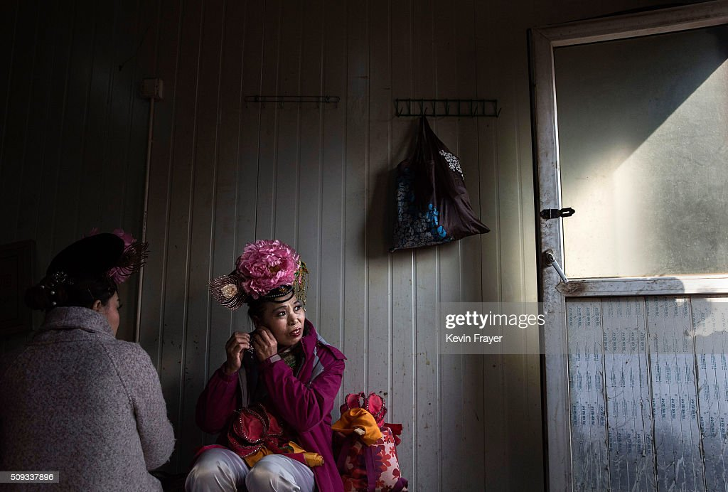 Chinese traditional dancers get ready in a trailer before performing at a local fair during Spring Festival celebrations on February 10, 2016 in Beijing, China. The Chinese Lunar New Year also known as the Spring Festival, which is based on the Lunisolar Chinese calendar, is celebrated from the first day of the first month of the lunar year and ends with Lantern Festival on the fifteenth day. This new year marks the Year of the Monkey.