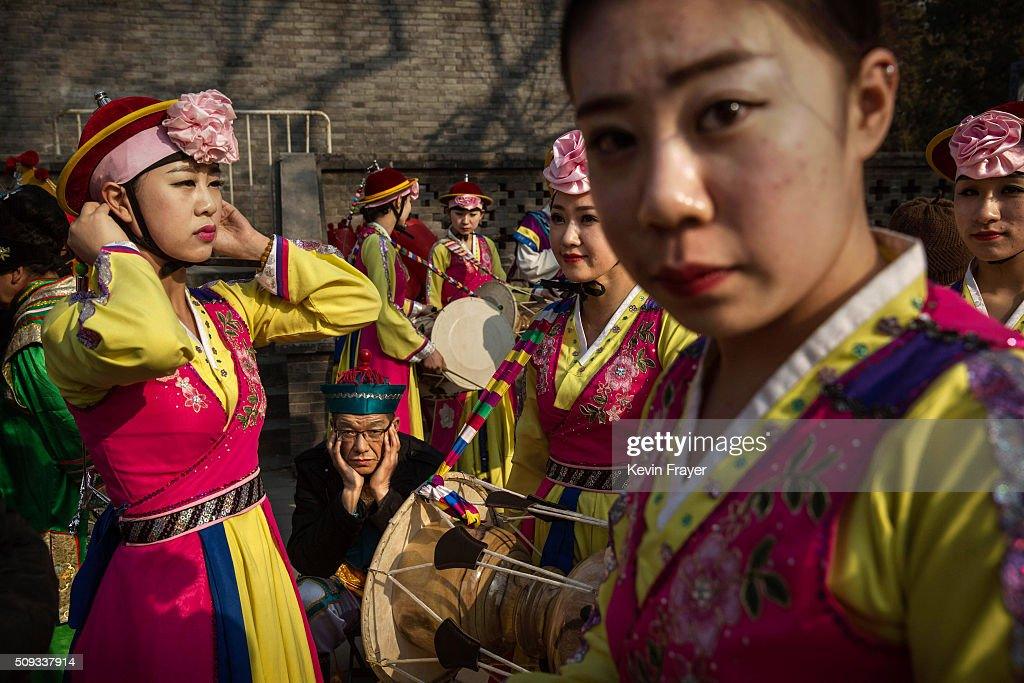 Chinese traditional dancers wait before performing at a local fair during Spring Festival celebrations on February 10, 2016 in Beijing, China. The Chinese Lunar New Year also known as the Spring Festival, which is based on the Lunisolar Chinese calendar, is celebrated from the first day of the first month of the lunar year and ends with Lantern Festival on the fifteenth day. This new year marks the Year of the Monkey.
