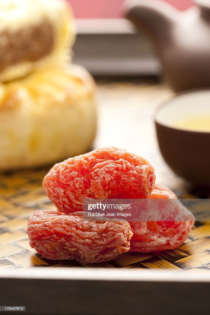 Chinese traditional preserved fruit and tea : Stock Photo