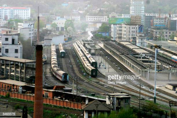 Chinese trains are seen at Dandong railway station which borders the North Korean town of Sinuiju on April 24 2004 in Dandong China On April 22 2004...