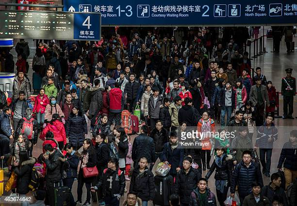 Chinese travelers crowd the station while leaving for the Spring Festival at a local railway station on February 17 2015 in Beijing China Millions of...