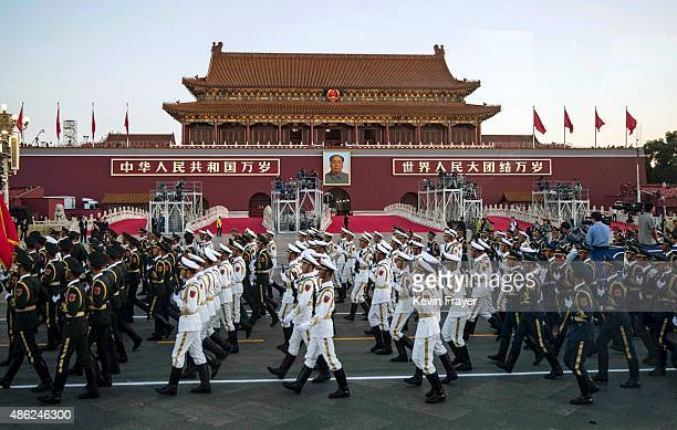 Chinese troops are seen from a bus as they walk past Tiananmen Gate before a military parade on September 3 2015 in Beijing China China is marking...