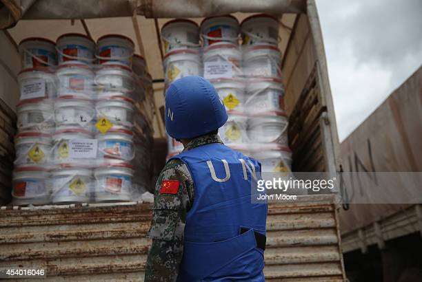 Chinese UN soldier prepares a truckload of Ebola relief aid after it was airlifted by the United Nations Children's Fund on August 23 2014 in Harbel...