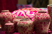 Collection of chinese vases imitation and pink pillow