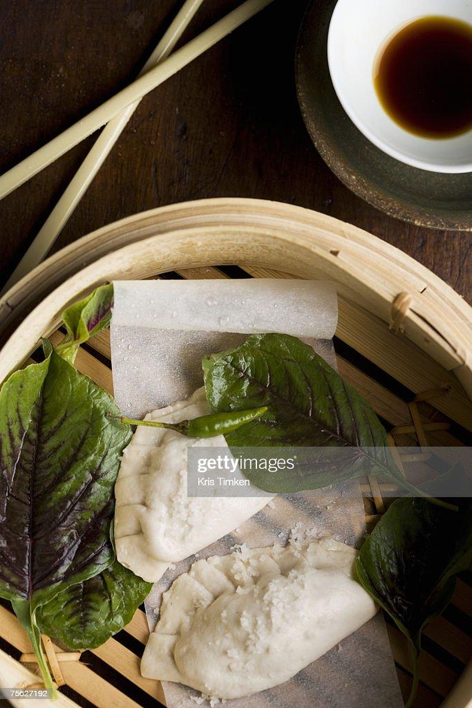 Chinese vegetable dumplings in steamer, overhead view : Stock Photo