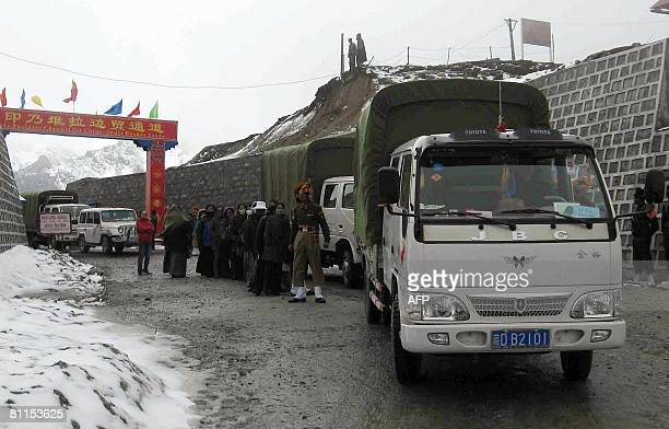 Chinese vehicles carring traders enter Indian territory after crossing the ChinaIndia border at the 15 000feet Nathu La Pass in India's northeastern...