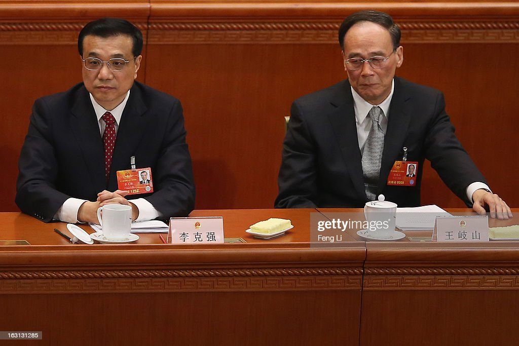 Chinese Vice Premier Li Keqiang (L) and Chinese Vice Premier Wang Qishan (R) attend the opening session of the annual National People's Congress in Beijing's Great Hall of the People on March 5, 2013 in Beijing, China. Chinese Premier Wen Jiabao stressed Tuesday that the government should adopt effective measures to prevent and control pollution in response to people's expectations of having a good living environment.