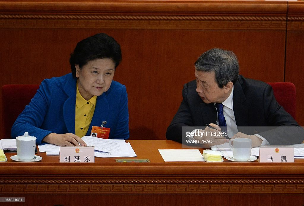 Chinese vice premier <a gi-track='captionPersonalityLinkClicked' href=/galleries/search?phrase=Liu+Yandong&family=editorial&specificpeople=4375362 ng-click='$event.stopPropagation()'>Liu Yandong</a> (L) talks to Vice Premier Ma Kai as they attend the opening of the third session of the 12th National People's Congress at the Great Hall of the People in Beijing on March 5, 2015. China's Communist Party-controlled legislature, the National People's Congress (NPC), gathers in the capital for the annual show of political theater, with the 'rule of law' high on the agenda.