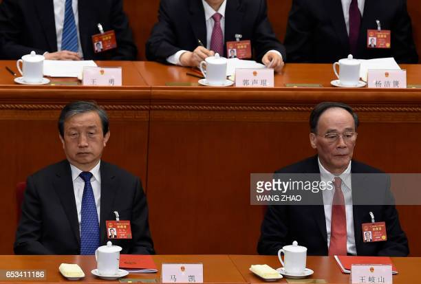 Chinese Vice Premier Ma Kai and Wang Qishan a member of the Standing Committee of the Political Bureau of the Communist Party of China Central...