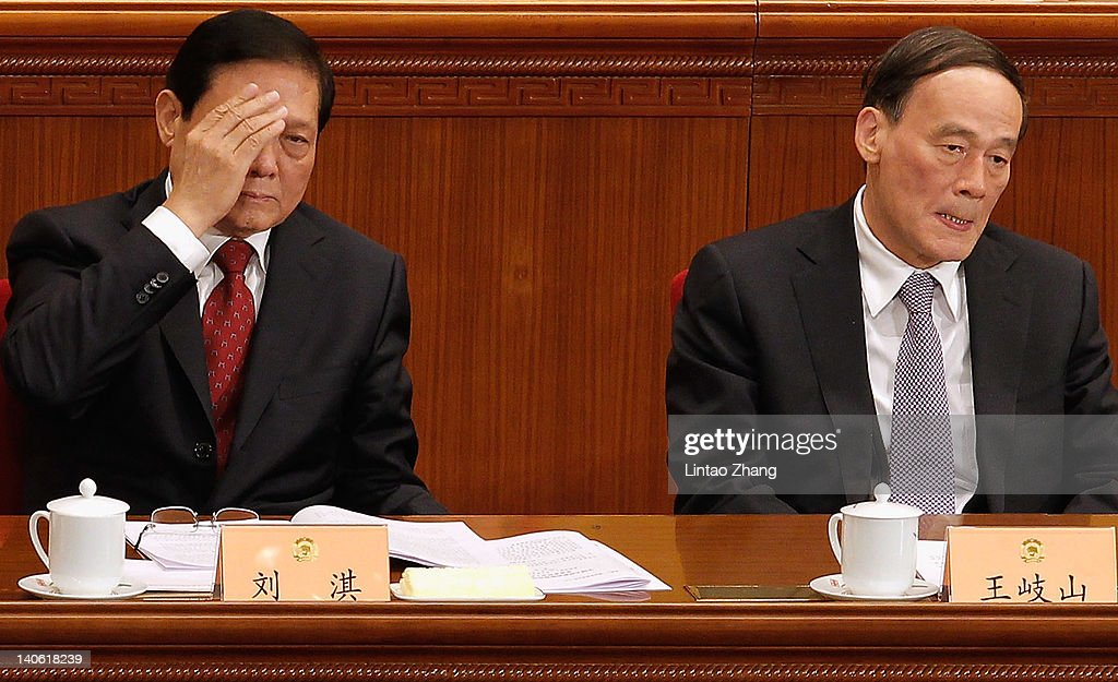 Chinese Vice Premier, <a gi-track='captionPersonalityLinkClicked' href=/galleries/search?phrase=Wang+Qishan&family=editorial&specificpeople=692964 ng-click='$event.stopPropagation()'>Wang Qishan</a> (R) and CPC secretary <a gi-track='captionPersonalityLinkClicked' href=/galleries/search?phrase=Liu+Qi+-+Chinese+Politician&family=editorial&specificpeople=621805 ng-click='$event.stopPropagation()'>Liu Qi</a> (L) attends the opening ceremony of the Chinese People's Political Consultative Conference at the Great Hall of the People on March 3, 2012 in Beijing, China. The Chinese People's Political Consultative Conference opens on March 3 in Beijing.