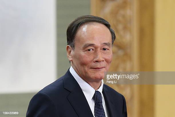 Chinese Vice Premier Wang Qishan one of the members of new sevenseat Politburo Standing Committee greets the media at the Great Hall of the People on...