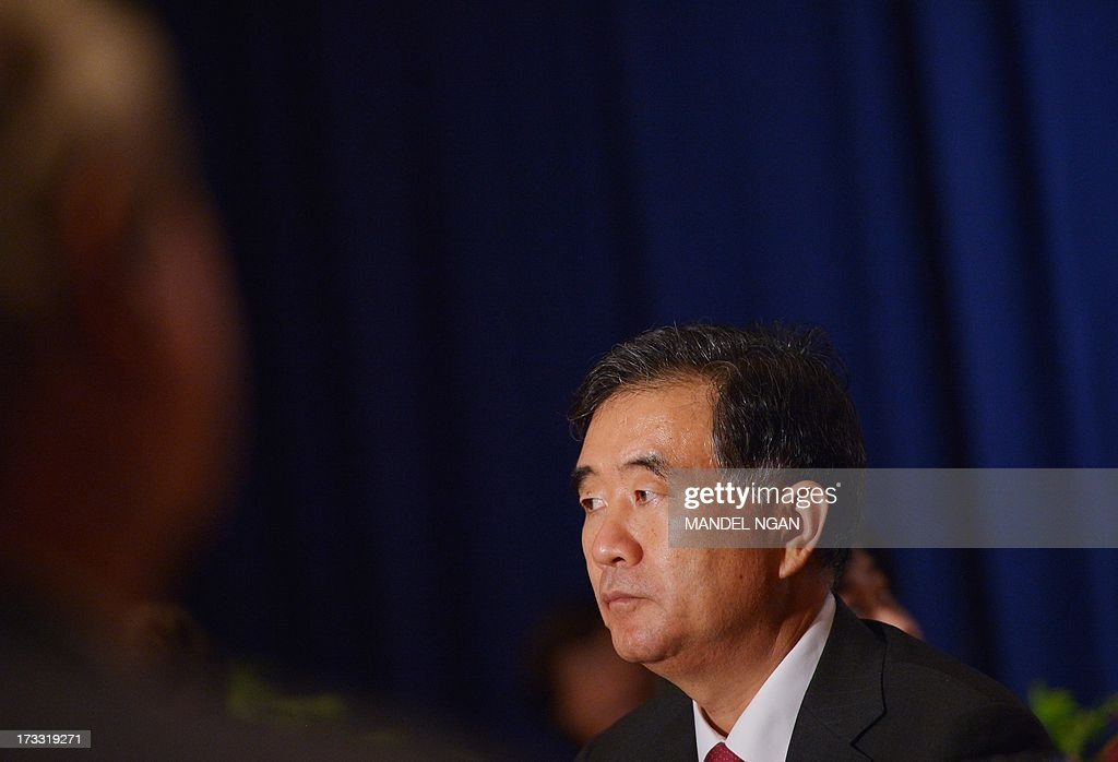 Chinese Vice Premier Wang Yang listens as Chinese State Councilor Yang Jiechi (not pictured) speaks at a dinner hosted by the US-China Business Council (USCBC) and National Committee on US-China Relations (NCUSCR) on July 11, 2013 at a hotel in Washington, DC. AFP PHOTO/Mandel NGAN