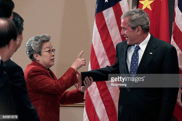 Chinese Vice Premier Wu Yi left meets with US President George W Bush at the Eisenhower Executive Office Building in Washington DC May 24 2007...
