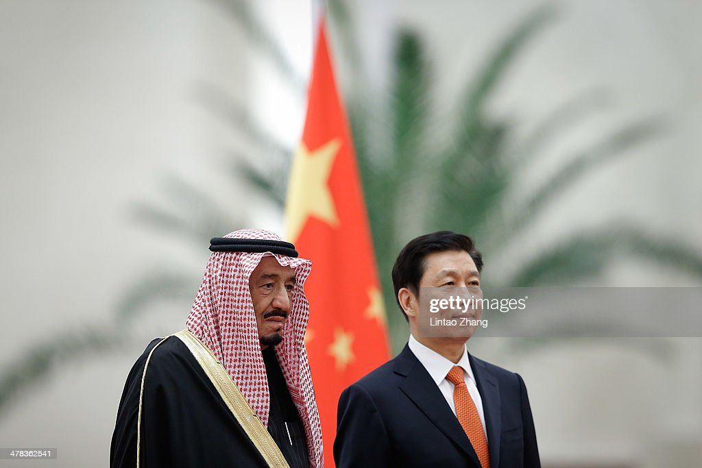 Chinese Vice President Li Yuanchao (R) with Saudi Crown Prince Salman bin Abdulaziz (L) listen to their national anthems during a welcoming ceremony inside the Great Hall of the People on March 13, 2014 in Beijing, China. Saudi Crown Prince Salman bin Abdulaziz will pay a four-day state visit to China from March 13 to 16.