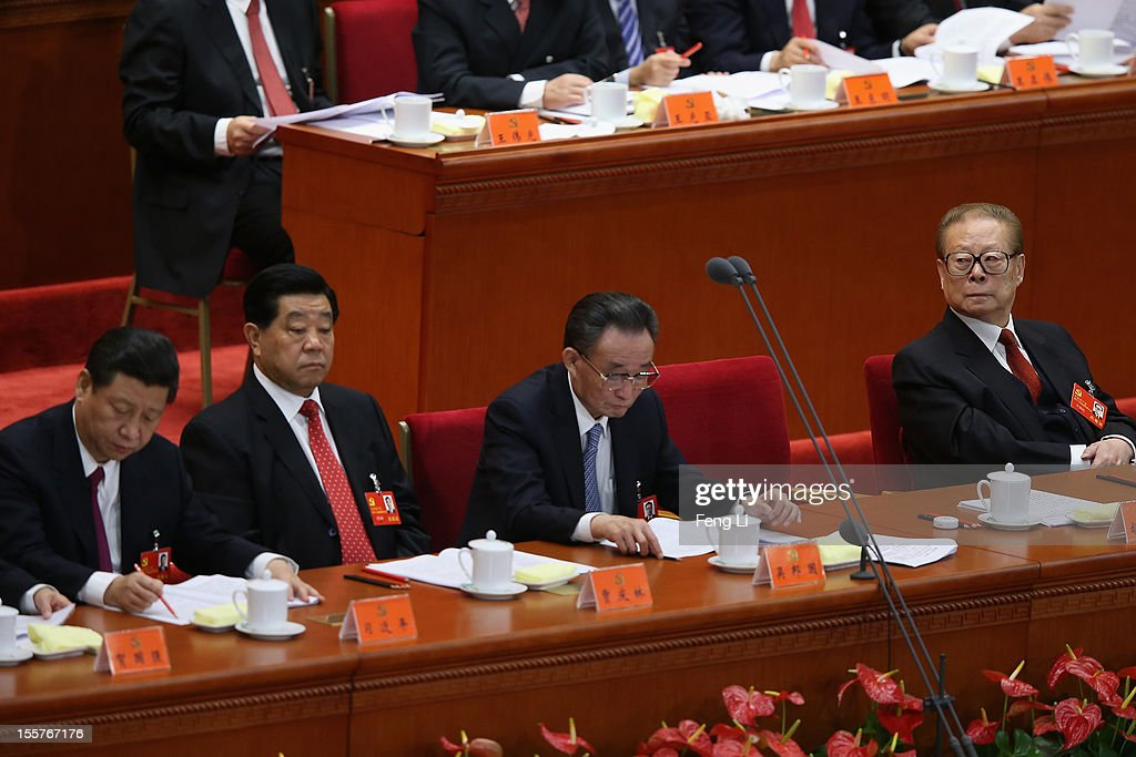 Chinese Vice President Xi Jinping and former Chinese President Jiang Zemin attend the opening session of the 18th Communist Party Congress held at...