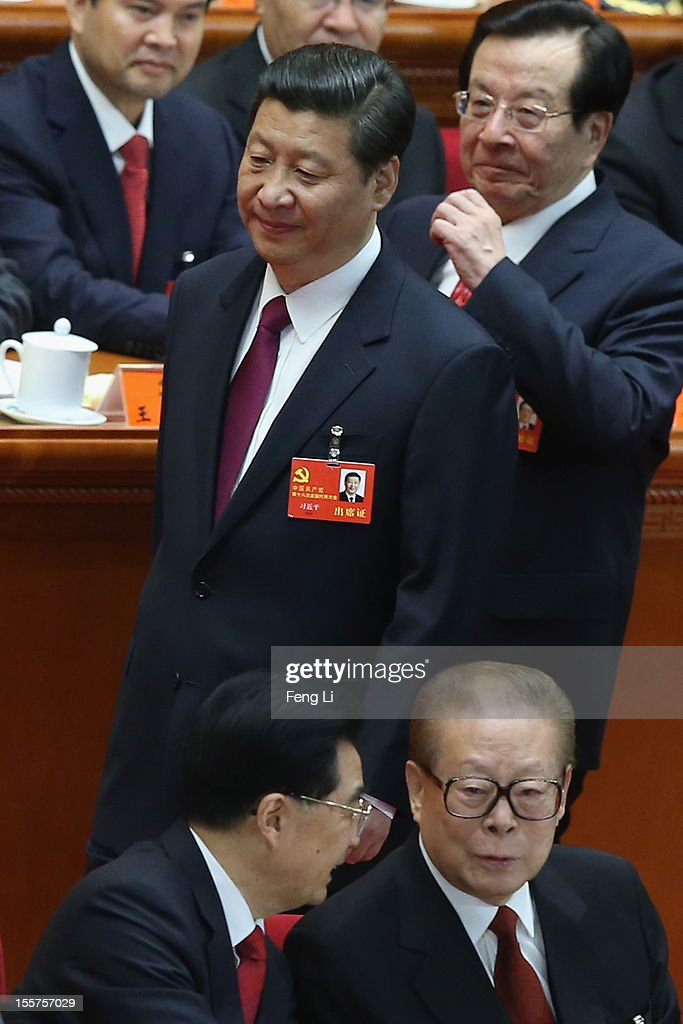 Chinese Vice President Xi Jinping and former Chinese Vice President Zeng Qinghong walk past Chinese President Hu Jintao and former Chinese President...