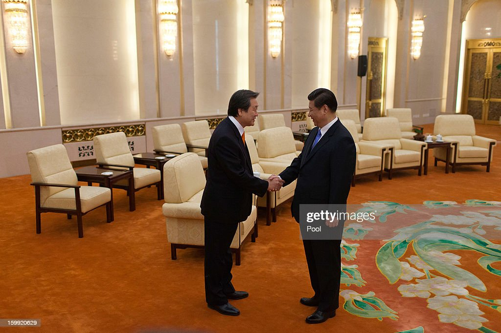 Chinese Vice President Xi Jinping, (R) and Kim Moo-sung, special envoy sent by South Korean President-elect Park Geun-hye, shake hands before their meeting at the Great Hall of the People on January 23, 2013 in Beijing, China.