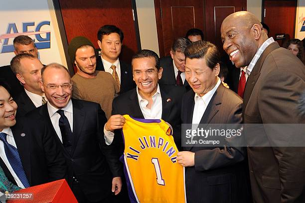 Chinese Vice President Xi Jinping is presented with a jersey by President and CEO of AEG China John Cappo Los Angeles Galaxy star David Beckham Los...