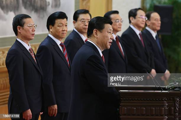 Chinese Vice President Xi Jinping one of the members of new sevenseat Politburo Standing Committee delivers a speech as Zhang Gaoli Liu Yunshan Zhang...