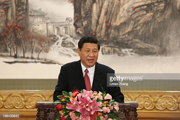 Chinese Vice President Xi Jinping one of the members of new sevenseat Politburo Standing Committee delivers a speech after being appointed the new...