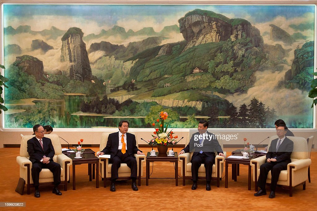 Chinese Vice President Xi Jinping, (C, R) talks with Kim Moo-sung, (C, L) special envoy sent by South Korean President-elect Park Geun-hye, during their meeting at the Great Hall of the People on January 23, 2013 in Beijing, China.