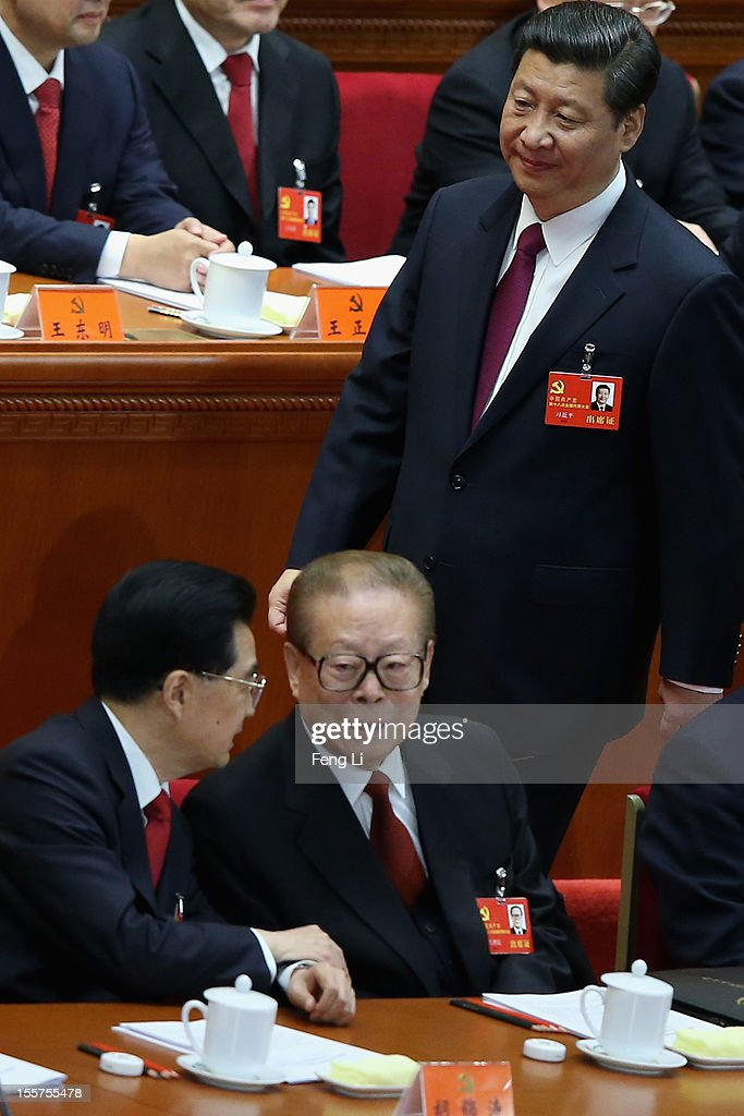 Chinese Vice President <a gi-track='captionPersonalityLinkClicked' href=/galleries/search?phrase=Xi+Jinping&family=editorial&specificpeople=2598986 ng-click='$event.stopPropagation()'>Xi Jinping</a> walks past Chinese President <a gi-track='captionPersonalityLinkClicked' href=/galleries/search?phrase=Hu+Jintao&family=editorial&specificpeople=203109 ng-click='$event.stopPropagation()'>Hu Jintao</a>, front left, and former Chinese President <a gi-track='captionPersonalityLinkClicked' href=/galleries/search?phrase=Jiang+Zemin&family=editorial&specificpeople=159399 ng-click='$event.stopPropagation()'>Jiang Zemin</a>, front right, during the opening session of the 18th Communist Party Congress held at the Great Hall of the People on November 8, 2012 in Beijing, China. The Communist Party Congress will convene from November 8-14 and will determine the party's next leaders.