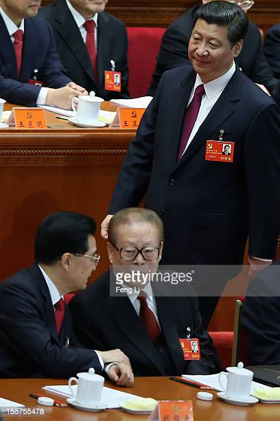 Chinese Vice President Xi Jinping walks past Chinese President Hu Jintao front left and former Chinese President Jiang Zemin front right during the...