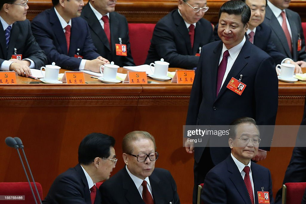 Chinese Vice President Xi Jinping walks past Chinese President Hu Jintao former Chinese President Jiang Zemin and Chinese Prime Minister Wen Jiabao...
