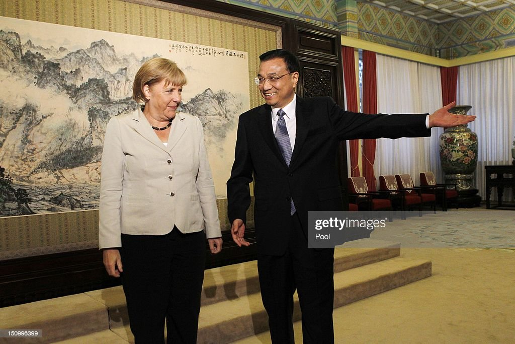 Chinese Vice-Premier <a gi-track='captionPersonalityLinkClicked' href=/galleries/search?phrase=Li+Keqiang&family=editorial&specificpeople=2481781 ng-click='$event.stopPropagation()'>Li Keqiang</a> (R) directs German Chancellor <a gi-track='captionPersonalityLinkClicked' href=/galleries/search?phrase=Angela+Merkel&family=editorial&specificpeople=202161 ng-click='$event.stopPropagation()'>Angela Merkel</a> to her seat during their meeting at the Zhongnanhai diplomatic compound on August 30, 2012 in Beijing, China. Merkel is on a two-day official visit to China.