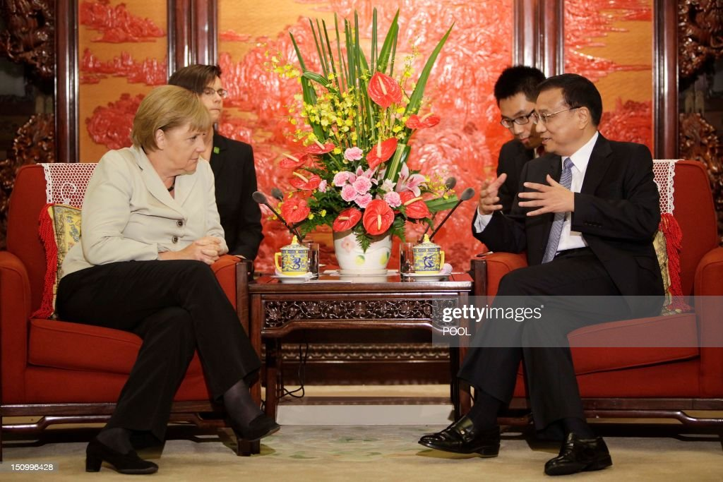 Chinese Vice-Premier Li Keqiang gestures as he speaks to German Chancellor Angela Merkel (L) during their meeting at the Zhongnanhai diplomatic compound in Beijing on August 30, 2012. German leader Angela Merkel is holding top-level talks on her second visit to China this year, with Europe's debt crisis taking centre stage as it begins to drag on the two global powers. Leading several ministers and a high-powered business delegation, Merkel will meet Premier Wen Jiabao in Beijing during the two-day trip and travel to an assembly plant of European planemaker Airbus in nearby Tianjin city.