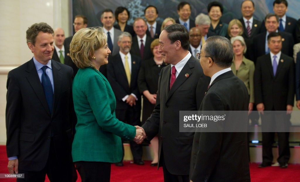 Chinese Vice-Premier Wang Qishan (2nd R) and Chinese State Councilor Dai Bingguo (R), greet US Secretary of State Hillary Clinton (2nd L) and US Secretary of Treasury Timothy Geithner (L) prior to a family photo with US and Chinese officials at the Great Hall of the People in Beijing on May 24, 2010, during the start of the second round of the US-China Strategic & Economic Dialogue. The US and China opened two days of high-level talks due to cover a wide range of issues including tensions over the sinking of a South Korean warship, blamed on Pyongyang. AFP PHOTO / POOL / Saul LOEB