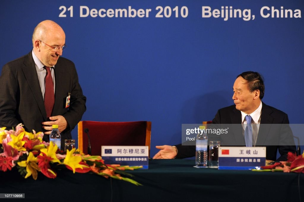 Chinese Vice-Premier <a gi-track='captionPersonalityLinkClicked' href=/galleries/search?phrase=Wang+Qishan&family=editorial&specificpeople=692964 ng-click='$event.stopPropagation()'>Wang Qishan</a> (R) gestures to European Commission Vice-President in charge of competition policy Joaquin Almuniain (L) before the start of a press conference during the 3rd EU-China High-level Economic and Trade Dialogue at the Diaoyutai State Guesthouse on December 21, 2010 in Beijing, China.