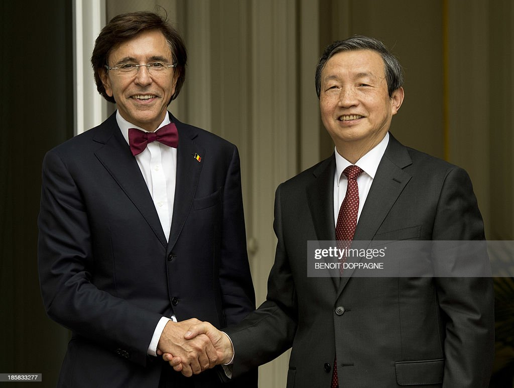 Chinese vice-Prime Minister Ma Kai is welcomed by Belgian Prime Minister Elio Di Rupo prior a meeting on October 25, 2013, in Brussels, after a visit a plant of Swedish carmaker Volvo in Gent.