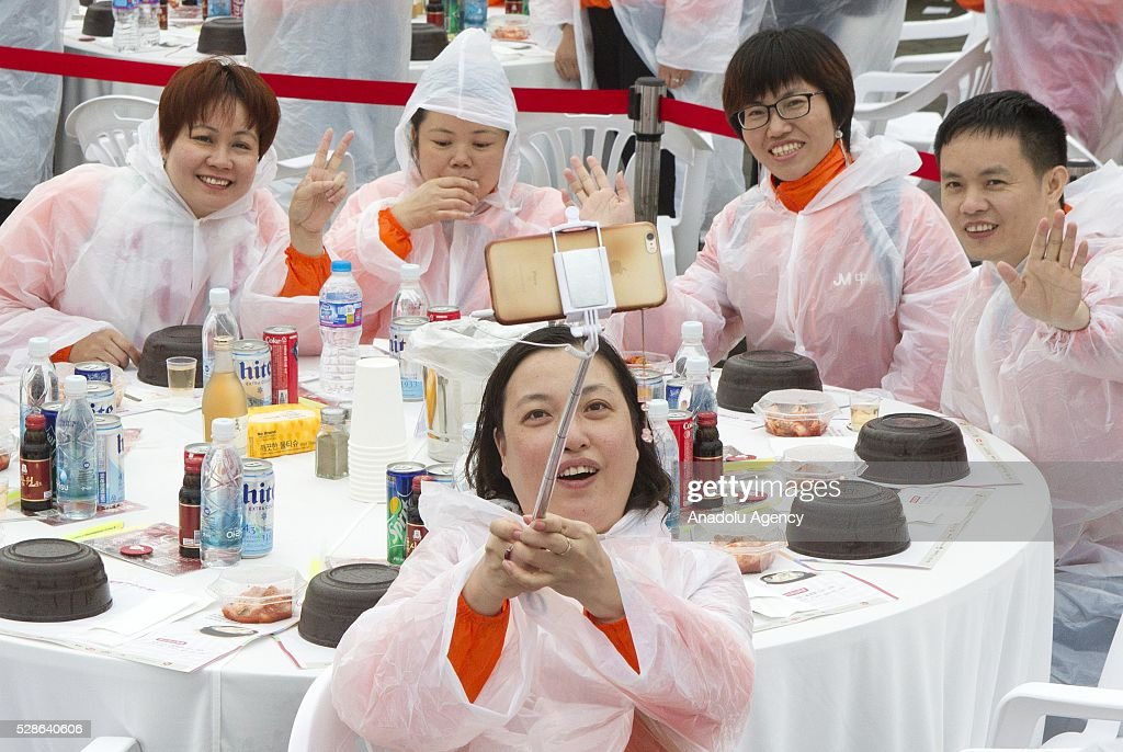 Chinese visitors take selfieas South Koreas capital Seoul is bustling with a huge group of tasting samgyetang in Seoul, South Korea on May 6, 2016. Almost 10,000 people, on their company-sponsored incentive trip as a reward for great performance. Koreas signature herbal chicken soup, party after sightseeing and shopping in and out of Seoul.