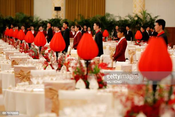 Chinese waiters and waitresses wait ahead a welcome banquet for the Belt and Road Forum at the Great Hall of the People in Beijing on May 14 2017...