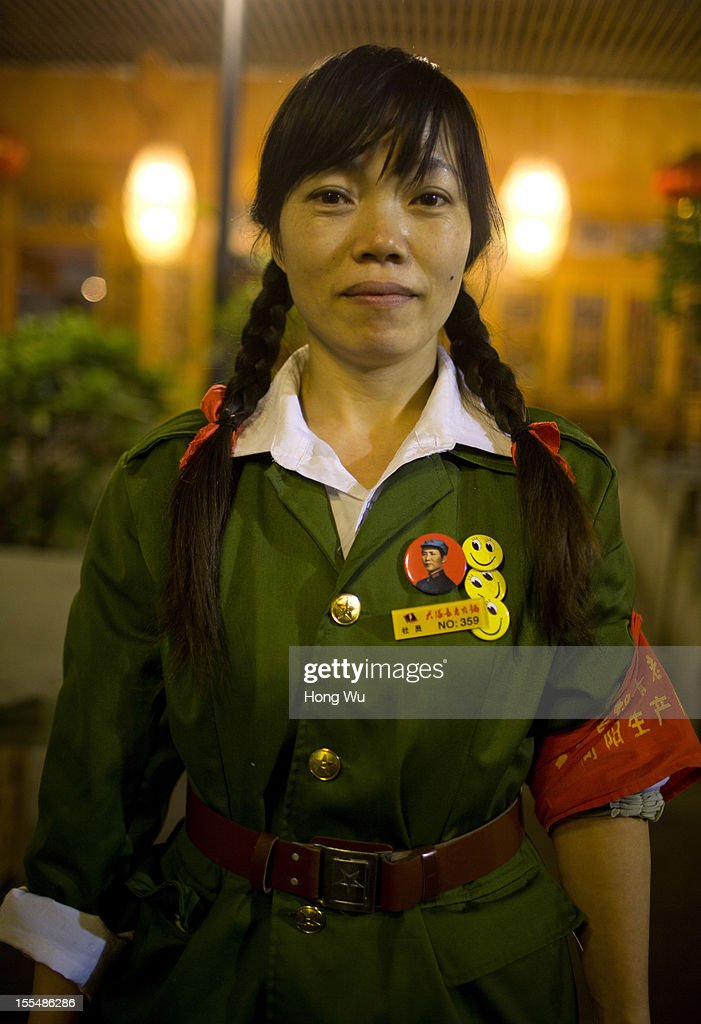A Chinese waitress wearing an old military uniform, serve guests at a chafing dish restaurant on November 4, 2012 in Chongqing, China. This theme restaurant, which was built in 2005, displays special Chinese red revolution culture of the 1970s that attracts customers with their old style decoration style and red revolution atmosphere.