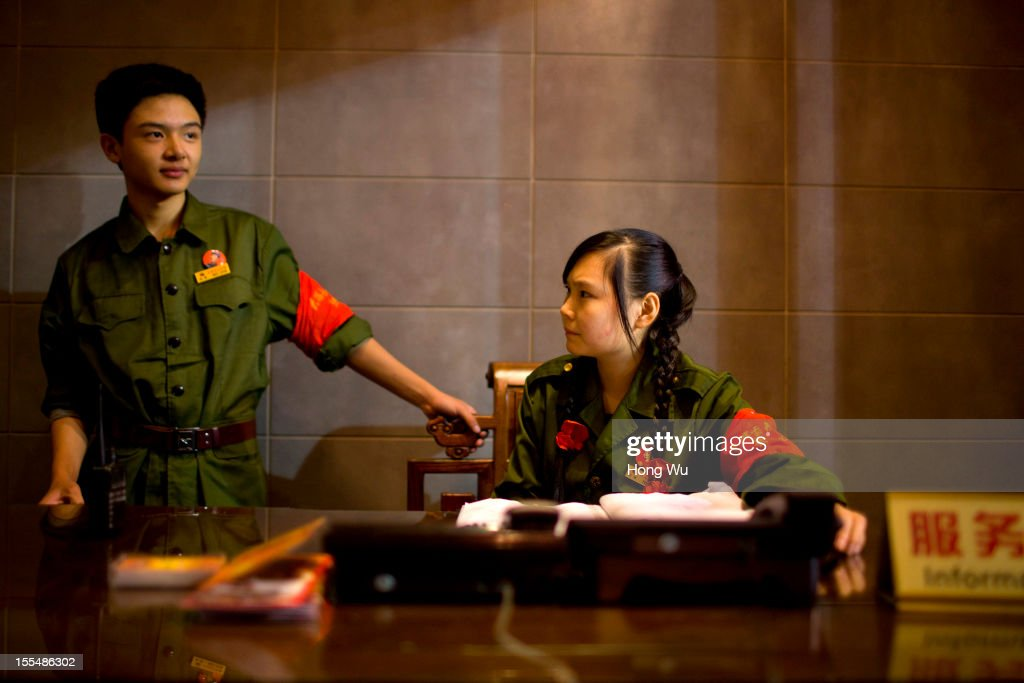 Chinese waitresses wearing old military uniform, serve guests at a chafing dish restaurant on November 4, 2012 in Chongqing, China. This theme restaurant, which was built in 2005, displays special Chinese red revolution culture of the 1970s that attracts customers with their old style decoration style and red revolution atmosphere.