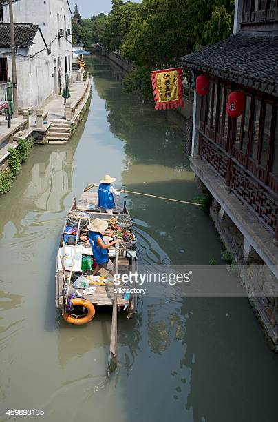 Chinese waste collectors working from boat in water city