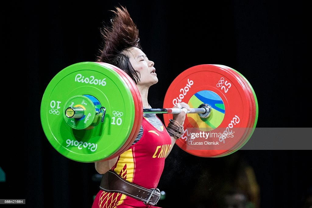 Chinese weightlifter Yanmei Xiang competes in the snatch portion of the women's 69kg weightlifting competition at the 2016 summer Olympic Games in...