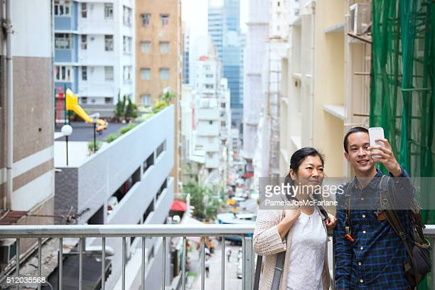 Chinese Woman and Man Taking Selfie, Mid-Levels Neighbourhood, Hong Kong