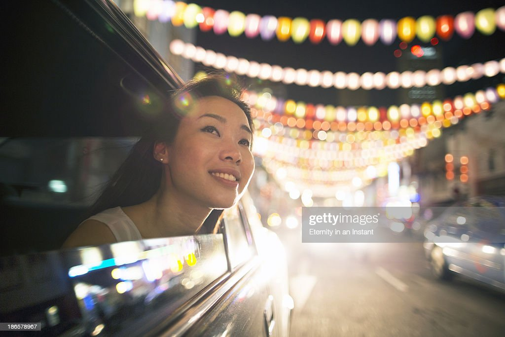Chinese woman in car looking at lanterns : Stock Photo