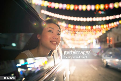 Chinese woman in car looking at lanterns