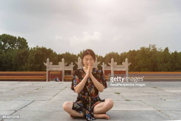 Chinese Woman Meditating in Sunlight